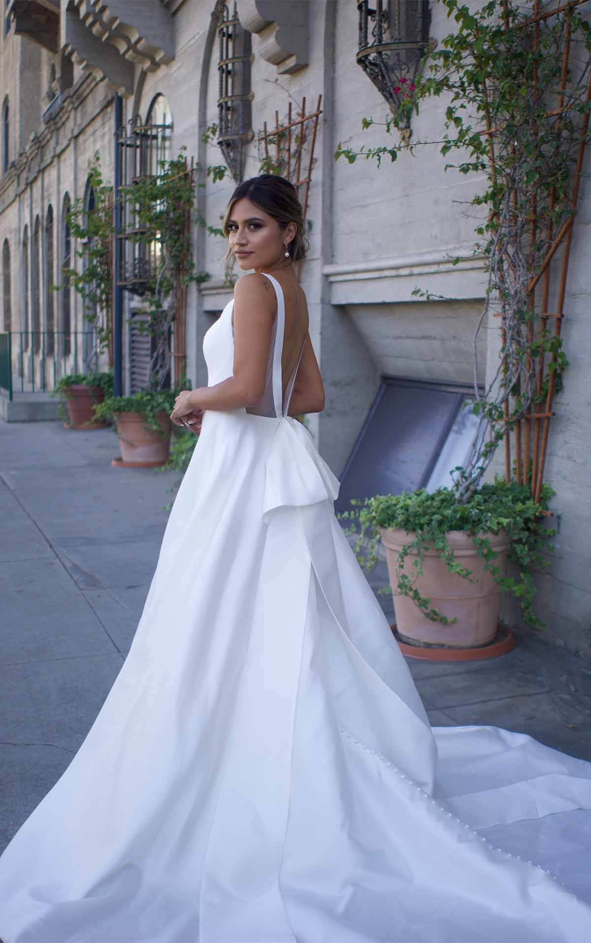 1275 Clean Modern Ballgown with Wide Straps and Bow by Martina Liana