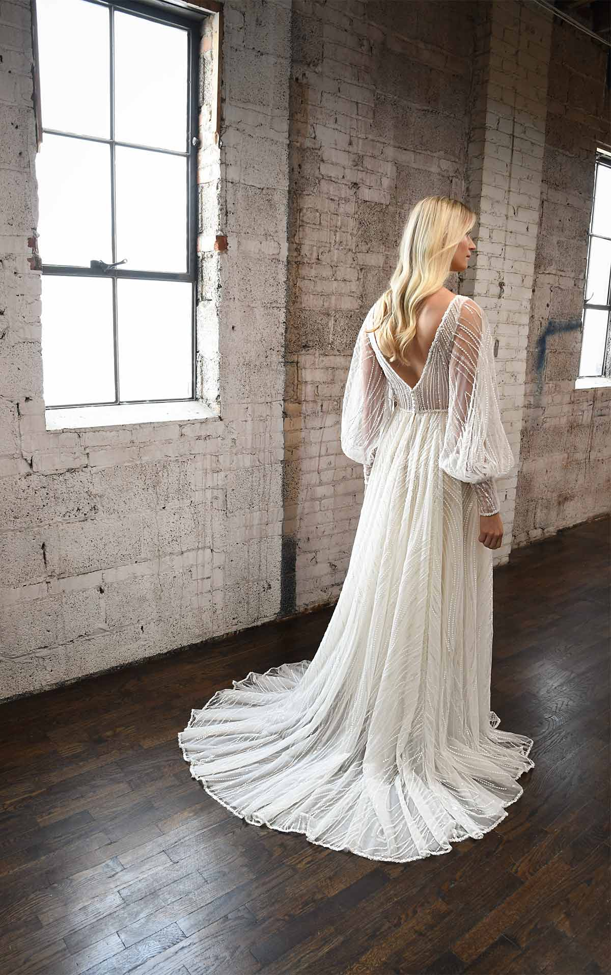 1335 Sparkling Boho-Inspired Wedding Dress with Bell Sleeves by Martina Liana