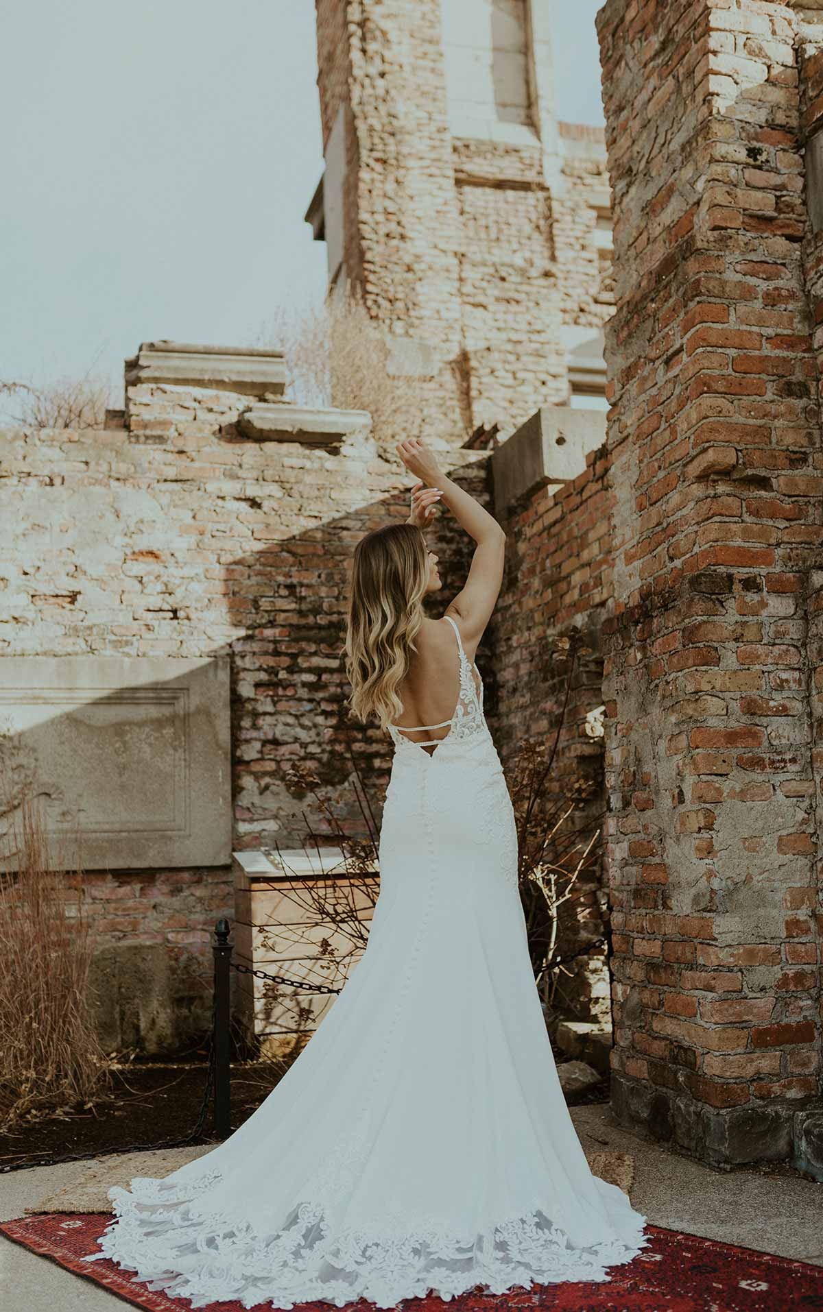 7324 V-Neckline Wedding Dress with Back Detail and Lace Train by Stella York