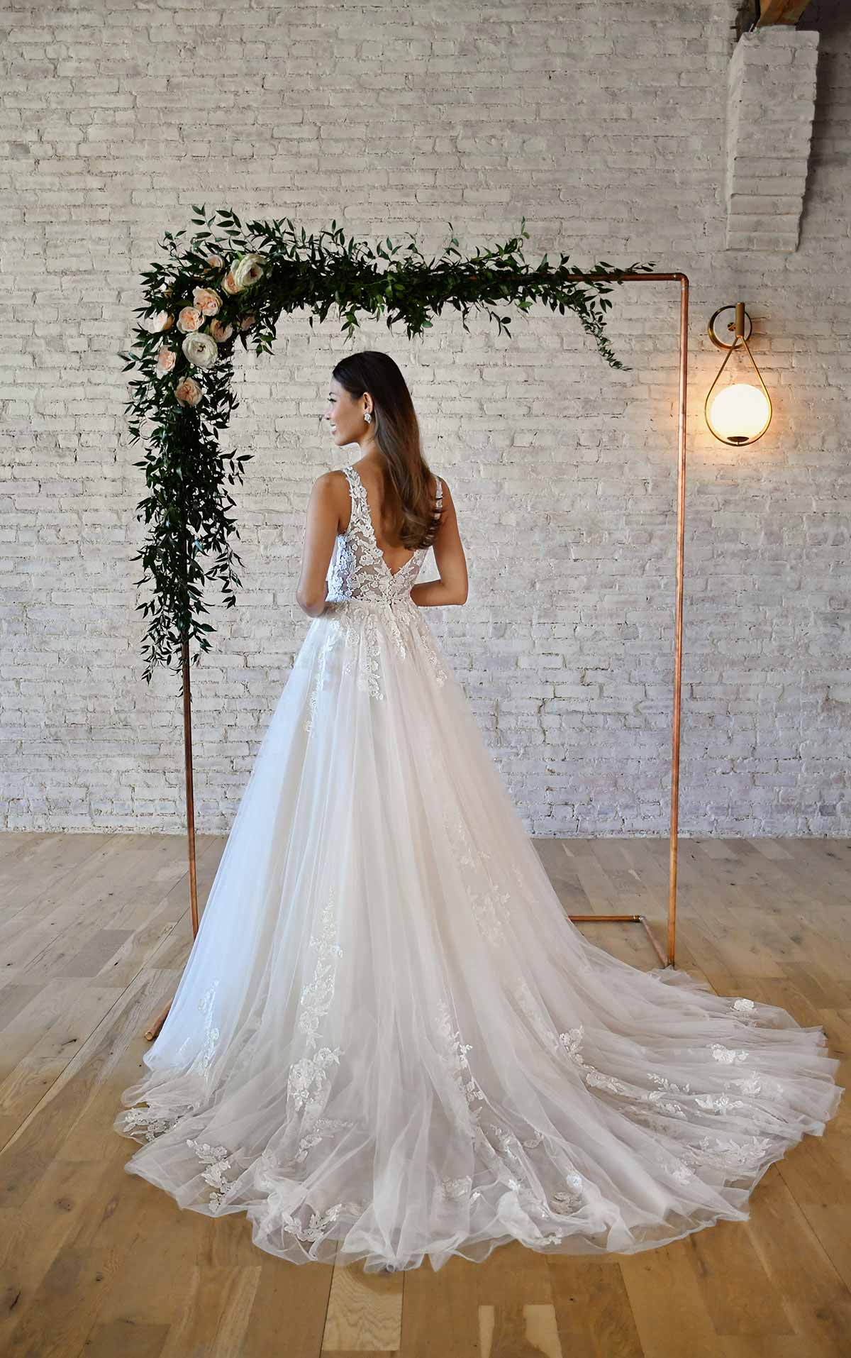 7194 Floral Lace Wedding Dress with Plunging V-Neckline by Stella York